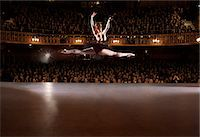 Ballet dancer performing on theater stage Stock Photo - Premium Royalty-Freenull, Code: 6113-07542907