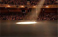 Spotlight shining on stage in theater Stock Photo - Premium Royalty-Freenull, Code: 6113-07542911