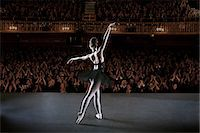 Ballerina performing on stage in theater Stock Photo - Premium Royalty-Freenull, Code: 6113-07542930