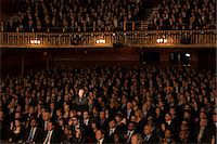Spotlight on audience members in theater Stock Photo - Premium Royalty-Freenull, Code: 6113-07542934