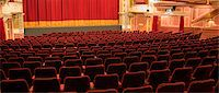 Empty chairs in theater Stock Photo - Premium Royalty-Freenull, Code: 6113-07542954