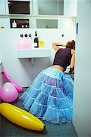 Woman vomiting into toilet at party Stock Photo - Premium Royalty-Freenull, Code: 6113-07542998