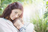 Mother holding baby girl outdoors Stock Photo - Premium Royalty-Freenull, Code: 6113-07543136