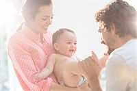 Parents playing with baby boy Stock Photo - Premium Royalty-Freenull, Code: 6113-07543142