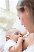 Mother breast-feeding baby boy Stock Photo - Premium Royalty-Freenull, Code: 6113-07543186