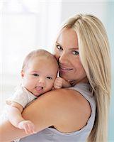 Mother holding baby girl Stock Photo - Premium Royalty-Freenull, Code: 6113-07543210