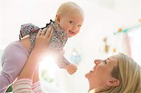 Mother playing with baby girl Stock Photo - Premium Royalty-Freenull, Code: 6113-07543232