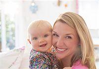 Mother holding baby girl Stock Photo - Premium Royalty-Freenull, Code: 6113-07543239
