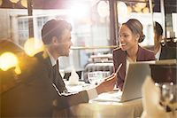 Business people talking in restaurant Stock Photo - Premium Royalty-Freenull, Code: 6113-07543434