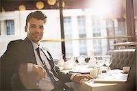 Businessman smiling in restaurant Stock Photo - Premium Royalty-Freenull, Code: 6113-07543444