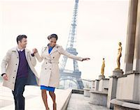 Couple walking in front of Eiffel Tower, Paris, France Stock Photo - Premium Royalty-Freenull, Code: 6113-07543586