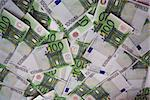 background from chaotically lyings one hundred euro banknotes