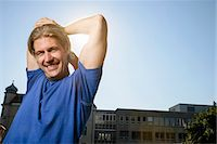 Mid adult man stretching during training on city rooftop Stock Photo - Premium Royalty-Freenull, Code: 649-07559758
