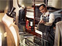 selecting - Tailor looking at fabric in traditional tailors shop Stock Photo - Premium Royalty-Freenull, Code: 649-07559864