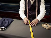 Tailor chalking measurements in traditional tailors shop Stock Photo - Premium Royalty-Freenull, Code: 649-07559871