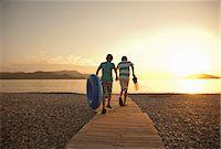 Teenage boy and brother running toward sea, Fethiye, Turkey Stock Photo - Premium Royalty-Freenull, Code: 649-07559944