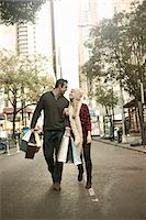 Young tourist couple with shopping bags, New York City, USA Stock Photo - Premium Royalty-Freenull, Code: 649-07559987