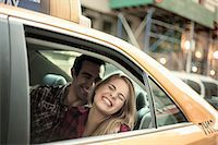Young couple laughing in yellow cab, New York City, USA Stock Photo - Premium Royalty-Freenull, Code: 649-07559993
