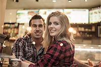 Young couple looking out of cafe window Stock Photo - Premium Royalty-Freenull, Code: 649-07559996