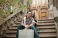 Young couple sitting on traditional city apartment steps Stock Photo - Premium Royalty-Freenull, Code: 649-07560005