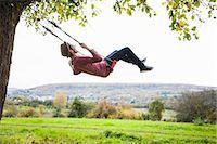 forward - Man on swing Stock Photo - Premium Royalty-Freenull, Code: 649-07560056