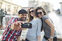 Tourist friends taking self portrait, Plaza de la Virgen, Valencia, Spain Stock Photo - Premium Royalty-Freenull, Code: 649-07560087