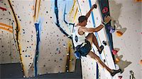 Mature man climbing with ropes on climbing wall Stock Photo - Premium Royalty-Freenull, Code: 649-07560192
