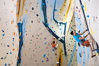 Man and woman climbing with ropes on climbing wall Stock Photo - Premium Royalty-Freenull, Code: 649-07560197