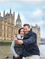 Mature tourist couple photographing selves and Houses of Parliament, London, UK Stock Photo - Premium Royalty-Freenull, Code: 649-07560242