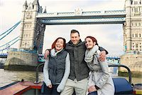 Friends sightseeing on Thames boat, London, UK Stock Photo - Premium Royalty-Freenull, Code: 649-07560243