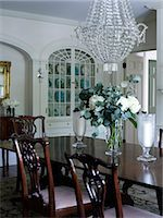Glass chandelier above dark wood dining table in Shelley Morris Designed Colonial style residence in New Canaan, Connecticut, USA Stock Photo - Premium Rights-Managed, Artist: Arcaid, Code: 845-07561504