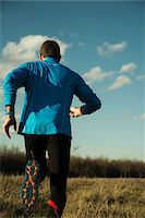 runner (male) - Back View of Mature Man Running Outdoors, Mannheim, Baden-Wurttemberg, Germany Stock Photo - Premium Rights-Managednull, Code: 700-07562396