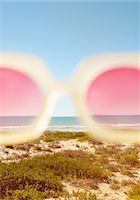 Cropped View of Rose-Coloured Sunglasses with Beach in the background Stock Photo - Premium Rights-Managed, Artist: ableimages, Code: 822-07562563