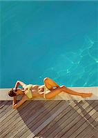 Woman Sunbathing by Swimming Pool, High Angle View Stock Photo - Premium Rights-Managednull, Code: 822-07562582