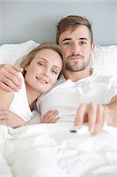 Couple in Bed Watching TV Stock Photo - Premium Rights-Managed, Artist: ableimages, Code: 822-07562644