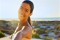 Smiling Young Woman with Arm Raised, Close-up View Stock Photo - Premium Rights-Managednull, Code: 822-07562697