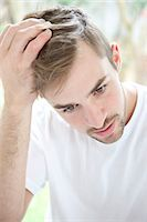 Portrait of Concerned Man Stock Photo - Premium Rights-Managednull, Code: 822-07562755