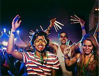 Fans with glow sticks cheering at music festival Stock Photo - Premium Royalty-Freenull, Code: 6113-07564769