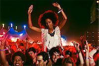 Cheering woman on man's shoulders at music festival Stock Photo - Premium Royalty-Freenull, Code: 6113-07564785