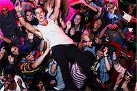 Man crowd surfing at music festival Stock Photo - Premium Royalty-Freenull, Code: 6113-07564799