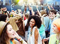 Fans dancing and cheering at music festival Stock Photo - Premium Royalty-Freenull, Code: 6113-07564801