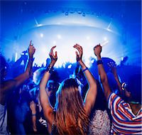 Fans dancing and cheering at music festival Stock Photo - Premium Royalty-Freenull, Code: 6113-07564818