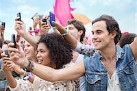 Fans with camera phones cheering at music festival Stock Photo - Premium Royalty-Freenull, Code: 6113-07564828