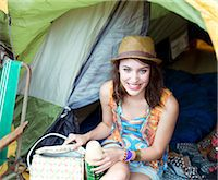 Portrait of smiling woman in tent at music festival Stock Photo - Premium Royalty-Freenull, Code: 6113-07564863