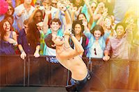 Fans cheering for performer singing on stage Stock Photo - Premium Royalty-Freenull, Code: 6113-07564883