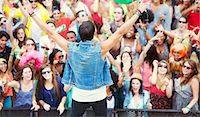Performer facing cheering crowd Stock Photo - Premium Royalty-Freenull, Code: 6113-07564907