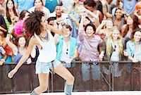 Fans cheering for performer singing on stage at music festival Stock Photo - Premium Royalty-Freenull, Code: 6113-07564913