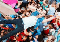Performer singing and crowd surfing at music festival Stock Photo - Premium Royalty-Freenull, Code: 6113-07564915