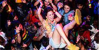 Enthusiastic woman crowd surfing at music festival Stock Photo - Premium Royalty-Freenull, Code: 6113-07564917