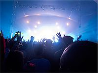 Silhouette of crowd facing stage at music festival Stock Photo - Premium Royalty-Freenull, Code: 6113-07564924